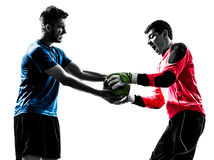 Two men soccer player goalkeeper  competition silhouette. Two caucasian soccer player goalkeeper men competition in silhouette isolated white background Royalty Free Stock Images