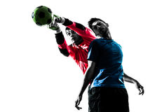 Two men soccer player goalkeeper punching heading ball competiti Stock Photo