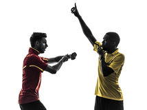 Two men soccer player and referee showing red card silhouette Royalty Free Stock Image