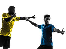 Two men soccer player and referee standing silhouette Royalty Free Stock Photography