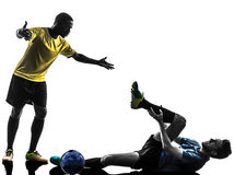 Two men soccer player standing complaining foul silhouette. Two men soccer player playing football competition complaining foul in silhouette on white background stock photo