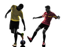 Two men soccer player  standing silhouette Stock Photo
