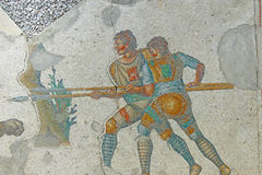 Two men with a spear fighting a tiger royalty free stock photos