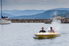 Two Men in a Speedboat Royalty Free Stock Photo