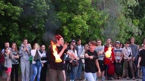 Two men spew fire. PERM, RUSSIA - JUN 7, 2015: Two men spew fire. Open rehearsal of fire-eatersn stock video