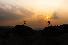 Two Men Stand On rocks Royalty Free Stock Image