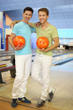 Two men stand together in bowling club Royalty Free Stock Images