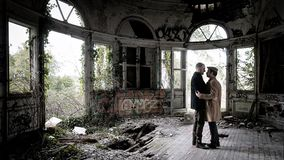 Two Men Standing on Brown Floor Inside Wrecked Building royalty free stock photos