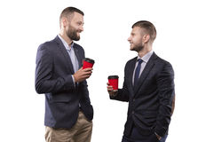Two men standing with a cup of coffee royalty free stock photography