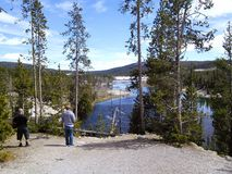 Two men standing near Yellowstone River Stock Image