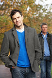 Two Men Standing Outside In Autumn Woodland Royalty Free Stock Image