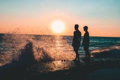 Two Men Standing on Seashore Royalty Free Stock Photo