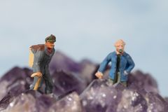 Male model miniature figures hiking. stock images