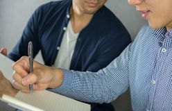 Two men studying close up, looking at other note royalty free stock photography