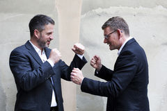 Two men in suits boxing Stock Photo