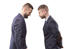 Two men in suits butting each other. And smiling Stock Photography