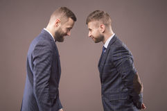 Two men in suits butting each other. And smiling Royalty Free Stock Photo