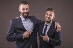 Two men in suits hugging Stock Photos