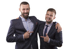 Two men in suits hugging royalty free stock image