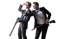 Two Men in Suits with Shotguns. Two men in suits hold a pair of double barreled shotguns and point into the distance. On white Royalty Free Stock Photography