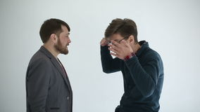 Two men swears at white background. Slow motion stock video footage