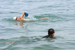 Two Men Swim In Lake Michigan Royalty Free Stock Photos