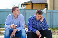 Two men taking a break for coffee Royalty Free Stock Image
