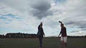 Men and flying plane. Two men taking selfie on background of flying plane stock video