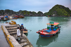 Two men talk on the docks of Cat Ba island Royalty Free Stock Photo