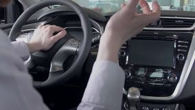 Two men talking in salon of luxury car and gesturing with their hands. slow motion. Two business men talking in salon of luxury car and gesturing with their stock video