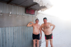 Two men in a thermal spring in winter, Tyumen Royalty Free Stock Photography