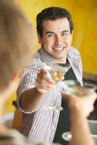 Two Men Toast With Martinis Stock Photography