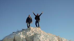 Two men tourists hiking adventure climbers climb the mountain. slow motion video. hiker walking goes on nature on the. Two men tourists hiking adventure climbers stock video