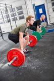 Two men train deadlift at crossfit center Stock Photography