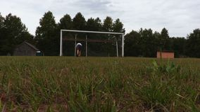 Two men training in football. In summer day stock footage
