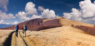 Two men traveling in the mountains Stock Images