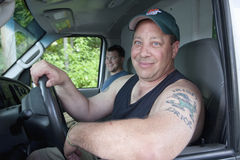 Two Men in Truck with Tattoo Royalty Free Stock Photography