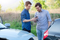 Two men trying to find an agreement after a car accident Stock Photo