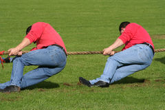 Two men in tug of war stock image