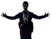 Two  men twin brother friends domination schyzophrenia concept s. Two  young men domination concept shadow white background Royalty Free Stock Photos