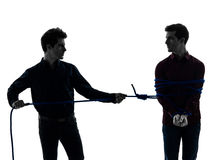 Two  men twin brother friends silhouette Stock Images
