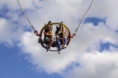 Two men undergo bungee revolutions at Oktoberfest, Stuttgart Stock Image
