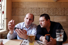 Two men using mobile phones Stock Photography