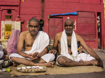 Two men in Varanasi. Two men sitting on the ghats of the holy city of Varanasi Royalty Free Stock Image