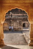 Two Men Via An Arch Of The Man Singh Palace Stock Photos