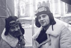 Two men in vintage military clothes on the Red Square in Moscow. MOSCOW - NOVEMBER 07, 2014: Two men in vintage military winter clothes pose for a photo on the Stock Photography