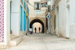 Two Men Walking in Medina (1). Two Men in Silhouette Walking in Traditional Tunisian Street Royalty Free Stock Image