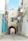 Two Men Walking in Medina (2). Two Men in Silhouette Walking in Traditional Tunisian Street Stock Images