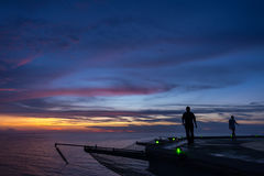 Two men walking on oil rig helipad Stock Images