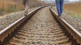 Two men walking on rail stock video